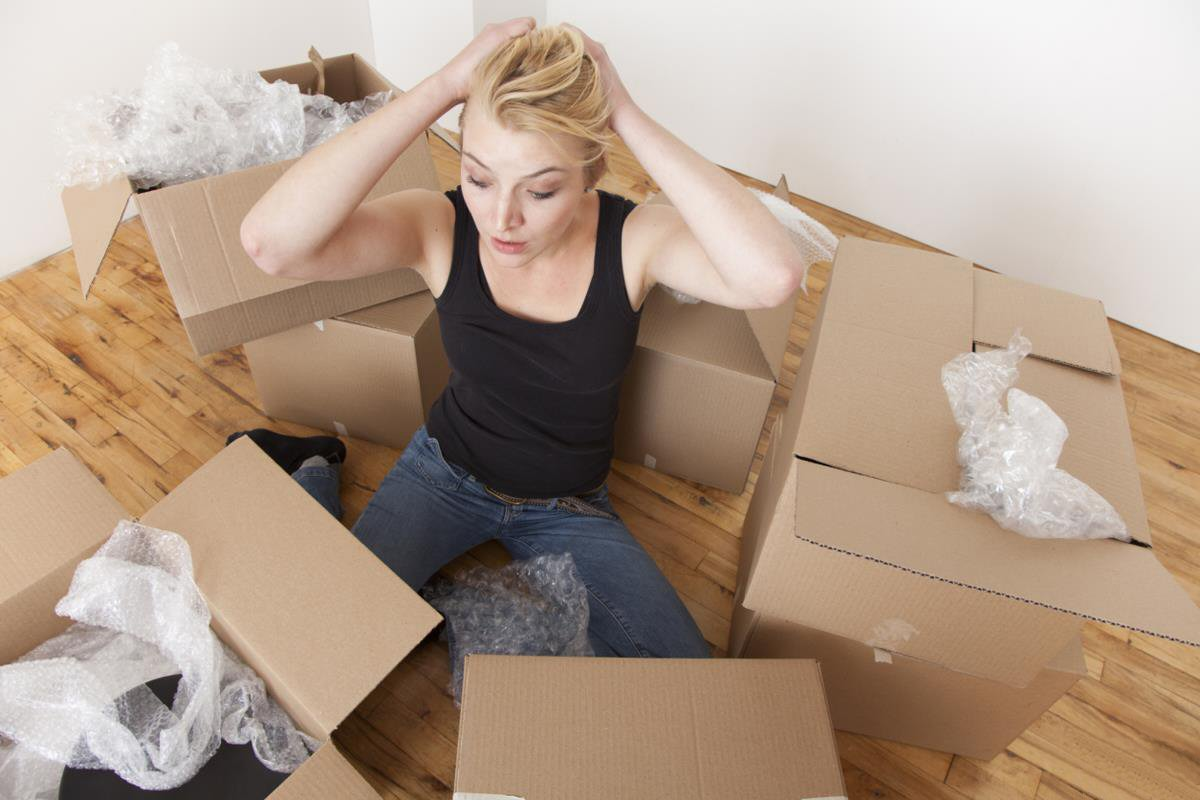 Caucasian woman unpacking boxes in new home